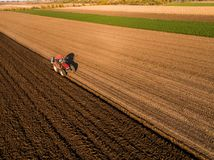 Aerial shot of a farmer plowing stubble field stock image