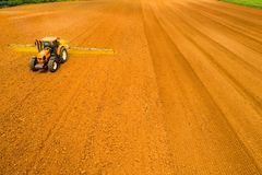 Aerial shot of Farmer with a tractor on the agricultural field stock photos