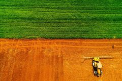 Aerial shot of Farmer with a tractor on the agricultural field royalty free stock photos