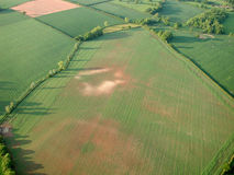 Aerial shot of fields with barren patches Stock Images