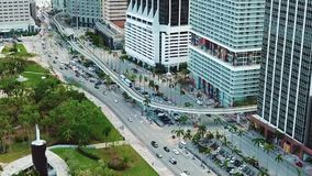Aerial shot of financial district with the largest business corporations and charming green park for relaxation on sunny