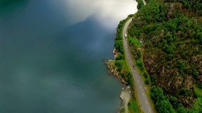 Aerial footage road in Norway. Beautiful Nature Norway. Aerial shot. Flight along coastline, long car asphalted road. Beautiful view. High mountains, covered stock video