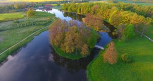 Aerial shot. Flight over a river, a forest and countryside. stock video