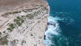 Aerial shot from flying drone. Rocks of sea coastline. Full HD video stock footage