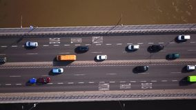 Aerial shot focuses on the traffic on the bridge. Cars driving. 4K stock video