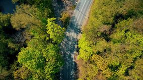 Aerial shot of a forest car road bend, top down view Stock Photography