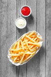 Aerial Shot of French Fries with Dipping Sauces Royalty Free Stock Photo