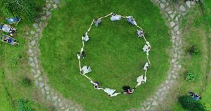 Aerial shot: Girls dancing in a circle at the festival of Ivan Kupala