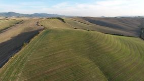 Aerial shot, gorgeous tuscany hills landscape with sunset light, tuscany flyover stock video