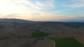 Aerial shot, gorgeous tuscany hills landscape with sunset light, tuscany flyover. Aerial shot, gorgeous tuscany hills landscape, flying above the fields stock video footage
