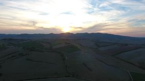 Aerial shot, gorgeous tuscany hills landscape with sunset light, tuscany flyover stock video footage