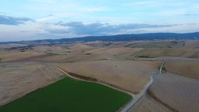 Aerial shot, gorgeous tuscany hills landscape with sunset light, tuscany flyover stock footage
