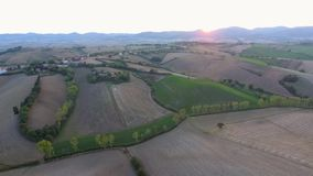 Aerial shot, gorgeous tuscany hills landscape with sunset light, tuscany flyover. Aerial shot, gorgeous tuscany hills landscape, flying above the fields stock footage