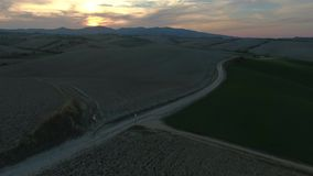 Aerial shot, gorgeous tuscany hills landscape with sunset light, tuscany flyover. Aerial shot, gorgeous tuscany hills landscape, flying above the fields stock video