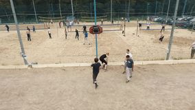 Aerial shot group of young people compete basketball at beach sports ground stock video footage