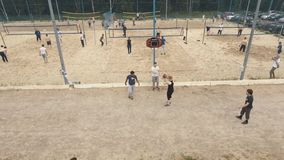 Aerial shot group of young people playing basketball at beach sports ground stock video