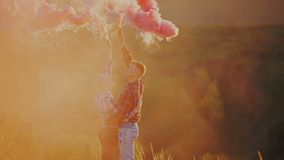 Couple with smoke bombs stock footage