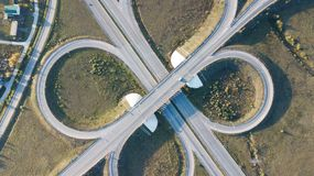 Aerial shot of highway junction with cars top view in the form of a sign of infinity.  royalty free stock photography