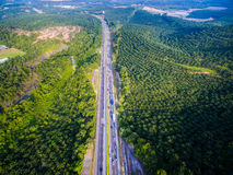 Aerial shot highway, road with forest, farm. Landscape Stock Photos