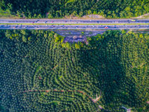 Aerial shot highway, road with forest, farm. Moving vehicles Royalty Free Stock Photos