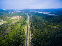 Aerial shot highway, road with forest, farm. With sky & clouds Stock Photography