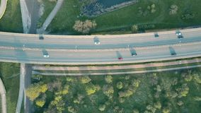 Aerial shot of a highway at sunset, top down view Stock Photos