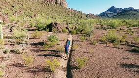 Aerial Shot of Hikers in Southwestern Desert stock video
