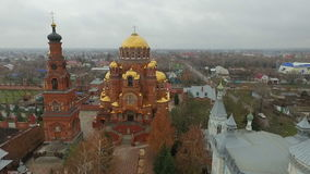 Aerial shot of Holy Trinity Convent of Mercy. Saraktash. Russia. Aerial. Passing by the golden dome of gates of the Trinity Lavra of St.Sergius in Sergiyev stock footage