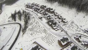 Aerial shot of houses on the hill in winter stock video footage