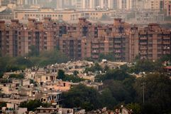 Aerial shot of housing apartments in Noida. Towering over old fashioned independent homes. These apartments are critical to house the ever growing population of Royalty Free Stock Photography