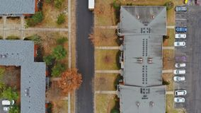 Aerial shot of housing c ommunity streets and residential buildings. Aerial shot of housing community streets and residential buildings in height view from above stock footage