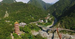 Aerial shot of Hsiangte temple and Tian feng tower inIn Taroko Gorge Taiwan. 4K Aerial shot of Hsiangte temple and Tian feng tower inIn Taroko Gorge Taiwan stock footage