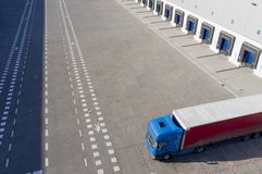 Aerial Shot of Industrial Warehouse Loading Dock, Truck with Semi Trailers Load Merchandise royalty free stock photo