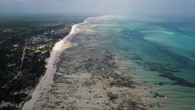 Aerial shot Jambiani Beach at Low tide in the Zanzibar. Large outflows on the island stock video
