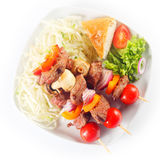 Aerial Shot of Kebabs with Bread and Veggies Stock Photos