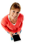Aerial shot of a lady using tablet pc. Pretty lady holding new tablet pc, aerial shot Stock Photography