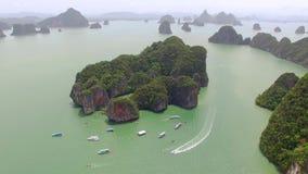 Aerial shot lagoon island sea Thailand. Fly over islands lagoon boat sea in Thailand, aerial shot stock video footage