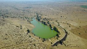 Lake in the middle of a desert. India. Aerial shot.Lake in the middle of a desert. India. Professional shot in 4K resolution. 024. You can use it e.g. in your stock footage