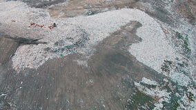 Aerial Shot Landfill with Working Trucks and Tractor. Top view stock video