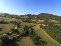 Aerial shot of little village of Collevecchio, Macerata, Italy. Surrounded by nature of Monti Sibillini National Park stock photo