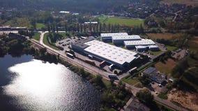 Aerial Shot Of Logistics Center With Trucks. Lake Nature. Logistics center. Trucks stock footage
