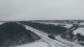 Aerial shot lonely train on railway in winter stock video