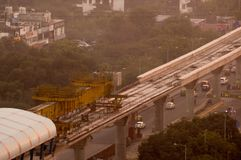 Aerial shot of metro track laying machine. Aerial photograph of a metro track laying machine working on an under construction track in Delhi, Lucknow, bangalore Royalty Free Stock Photo