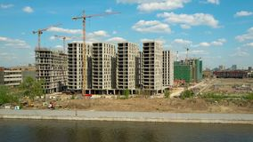 Aerial shot of a modern apartment buildings construction site near waterfront Stock Image