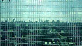 Aerial shot of modern office building windows reflecting cityscape on a sunny day Royalty Free Stock Image