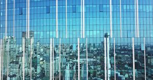 Cityscape reflection on a glass facade modern office Building in Kiev