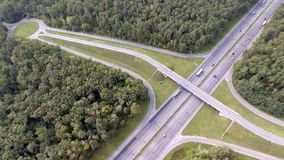 Aerial shot of motorway, freeway traffic - trucks and cars on the road.  stock video footage