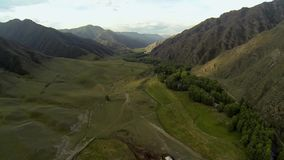 Aerial shot of mountain river valley stock video