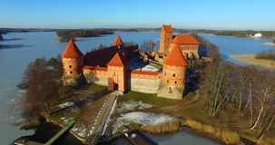 Aerial shot in move of Trakai old castle. Aerial shot of Trakai old castle and Galve lake, Lithuania stock footage