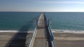 Aerial shot moving over pier on the Mediterranean sea stock video